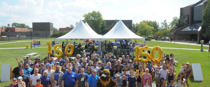 Members of the Northeastern Illinois University community pose for a group photo during NEIU Weekend on Sept. 16.