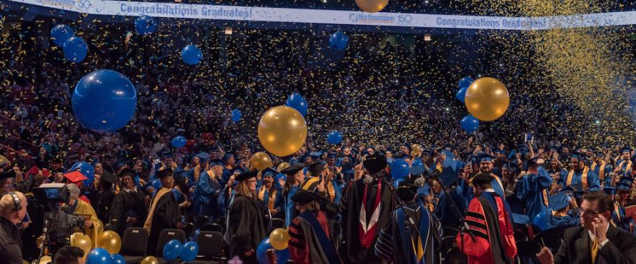 Confetti falls at the end of the Commencement ceremony on Dec. 17, 2017, at UIC Pavilion.