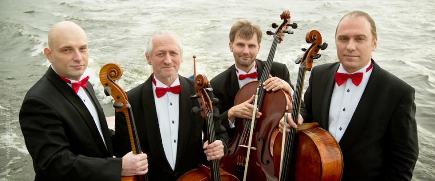 The members of the Rastrelli Cello Quartet pose with their instruments on a boat