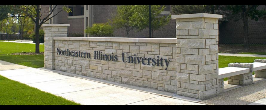 A low exterior, decorative wall bears the words Northeastern Illinois University