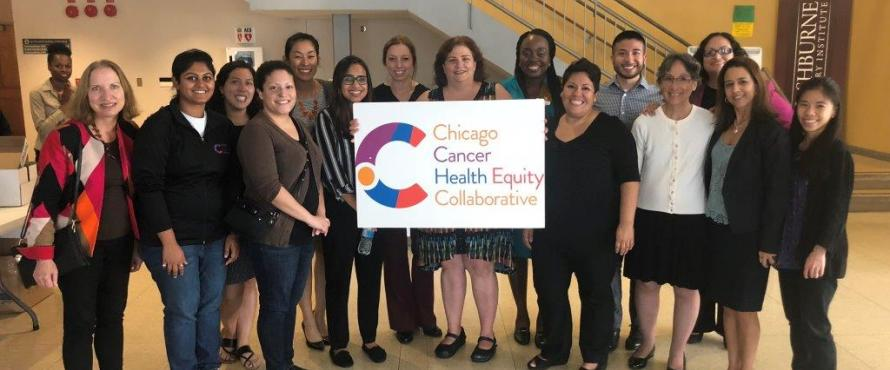 About 20 volunteers pose with a ChicagoCHEC sign.
