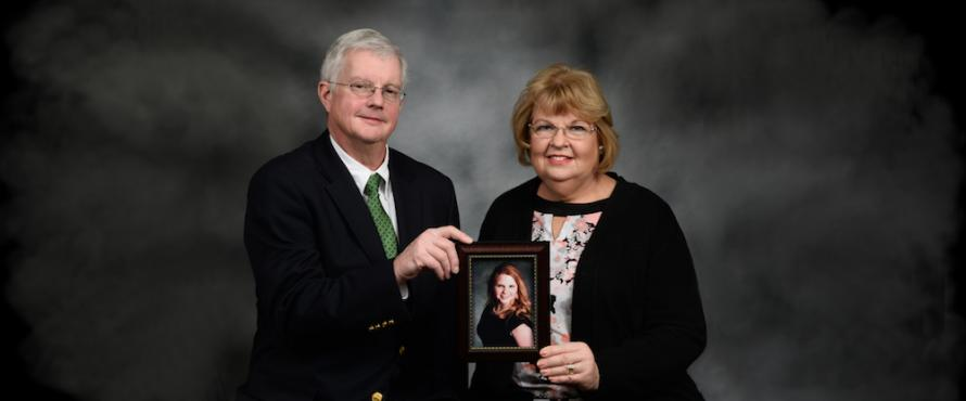 John and Eileen Kelly hold a photo of their daughter, Katie Kelly.