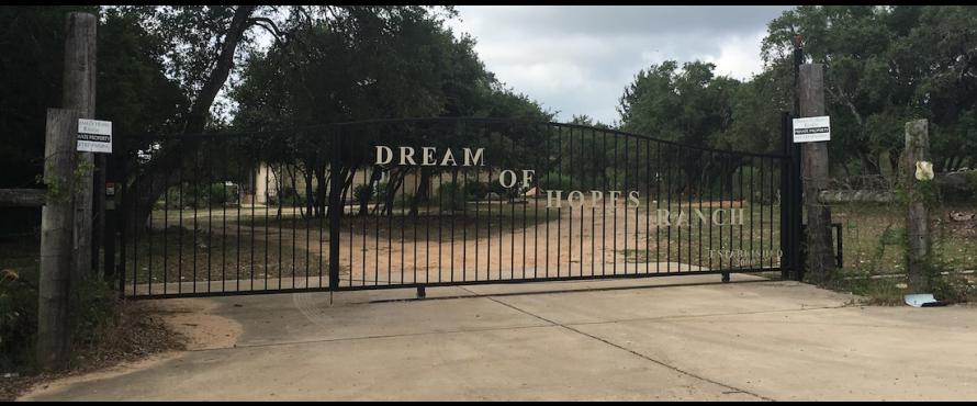 The front gate of Dream of Hopes Ranch.