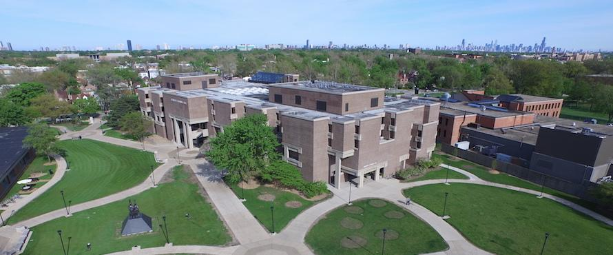 Aerial image of Northeastern's Bernard Brommel Hall with the Chicago skyline in the background