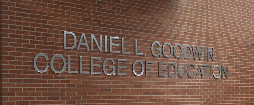 Brick will with the words Daniel L. Goodwin College of Education in silver lettering