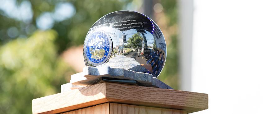 Northeastern's ceremonial orb reflects the sunlight.