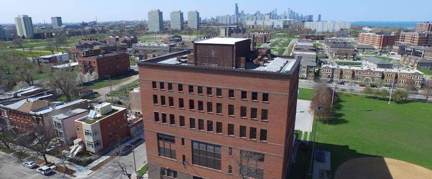 An aerial view of the Carruthers Center with the Chicago skyline in the background.