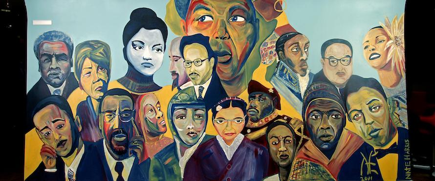 A mural of diverse faces in the Pedroso Center.