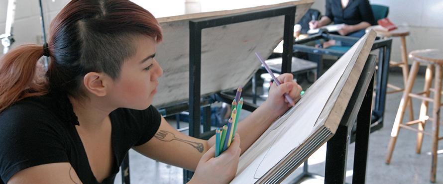Female student drawing in the art studio.