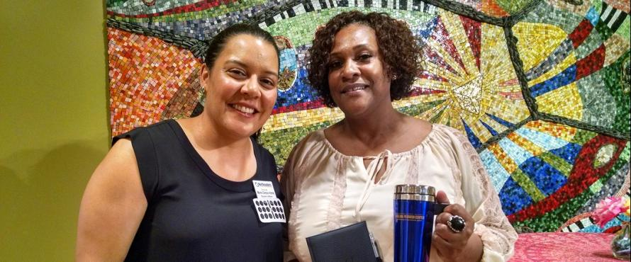 Scavenger hunt winner, student Cherry Blakely, receiving her prizes from Maria Genao-Homs, Executive Director, Pedroso Center.