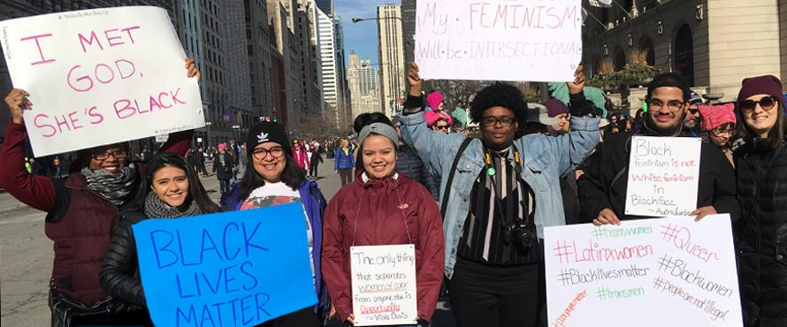 WGS Students hold signs at 2018 Women's March