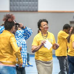 President Gibson and students dancing
