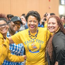 President Gibson poses smiling with attendees