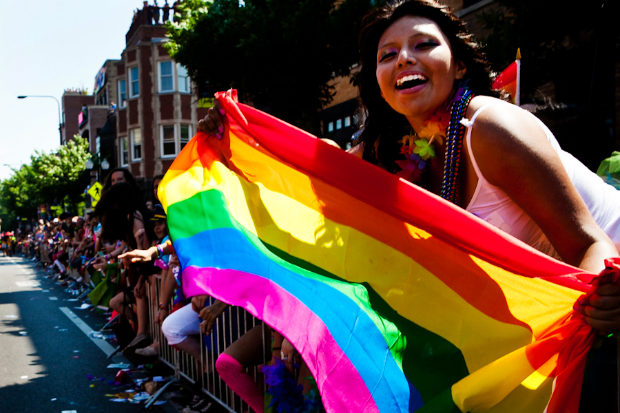 Woman holding a rainbow Pride flag