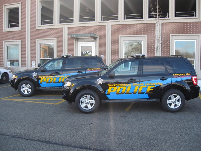 Police cars are shown parked at Northeastern.