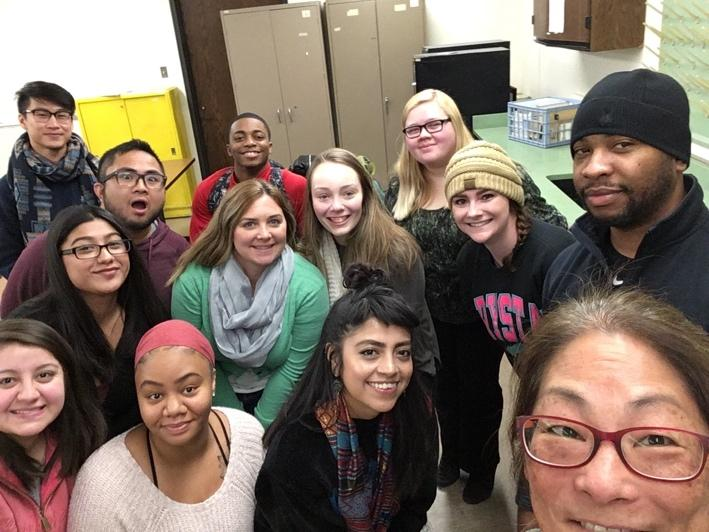 """Maureen and students in a classroom selfie """